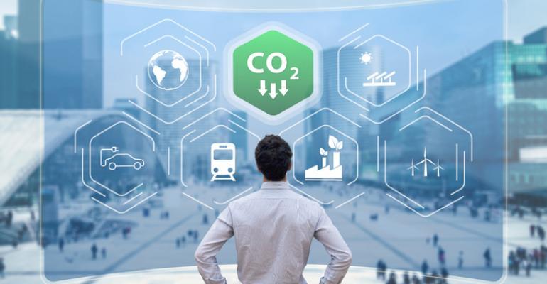 Business Man Looking At Green Carbon Emissions Symbol - Vertiv.jpg