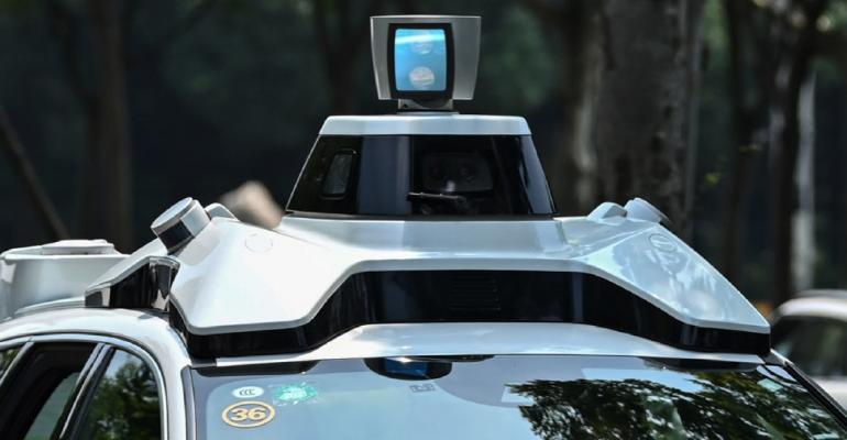 Didi Chuxing autonomous taxi during a pilot test drive on the streets in Shanghai in July 2020.