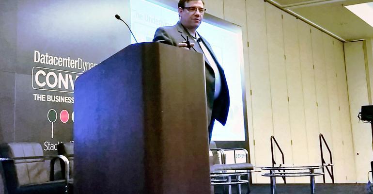 Eddie Schutter speaking at conference in 2015