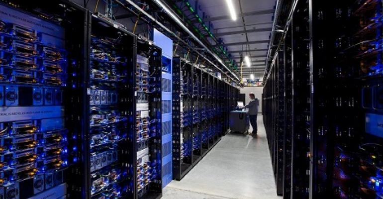 A technician at work in a data hall at Facebook's Altoona, Iowa, data center.