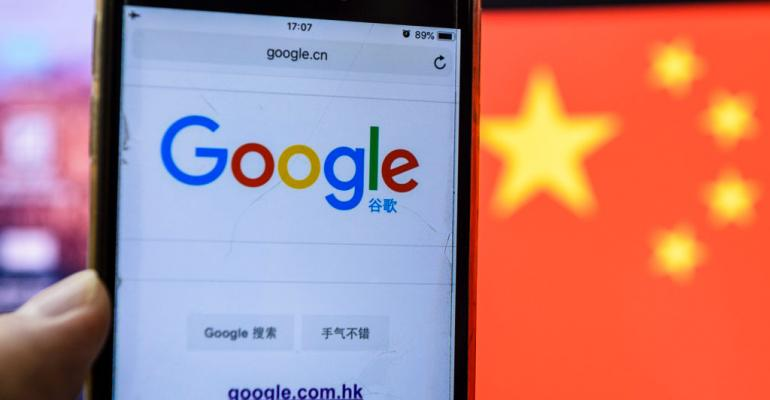 Google search on mobile screen in front of Chinese flag