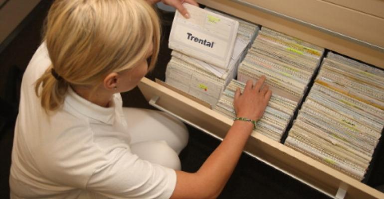 A nurse files patient records in Berlin, Germany.