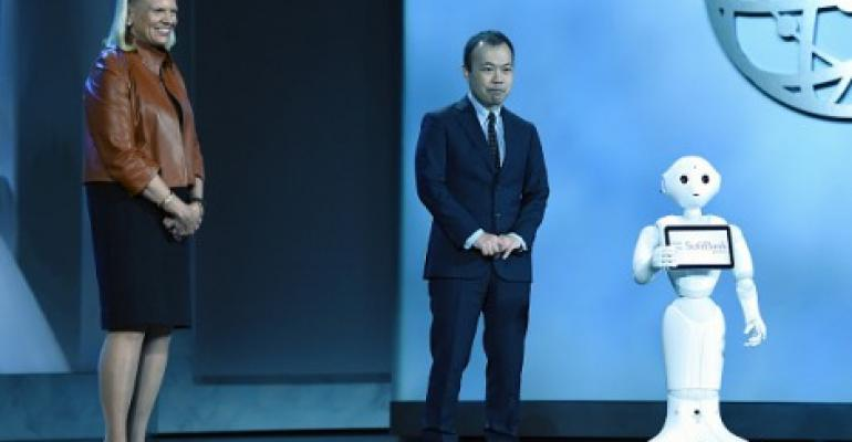 IBM CEO Ginni Rometty (L) looks on as Vice President of Business Development for SoftBank Robotics Kenichi Yoshida introduces SoftBank's emotion-reading robot Pepper during Rometty's keynote address at CES 2016 at The Venetian Las Vegas on January 6, 2016 in Las Vegas, Nevada.