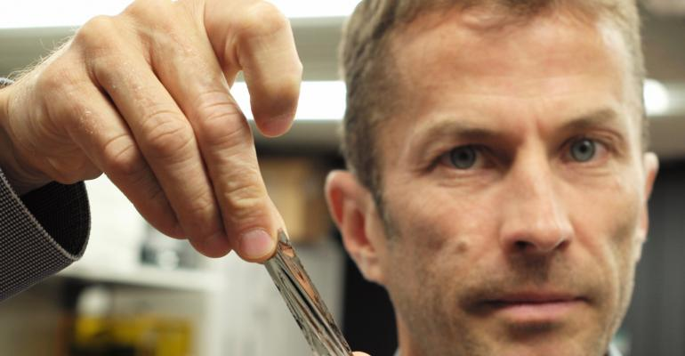 IBM scientist Dr. Mark Lantz, holds a one square inch piece of Sony Storage Media Solutions sputtered tape, which can hold 201 Gigabytes, a new world record.