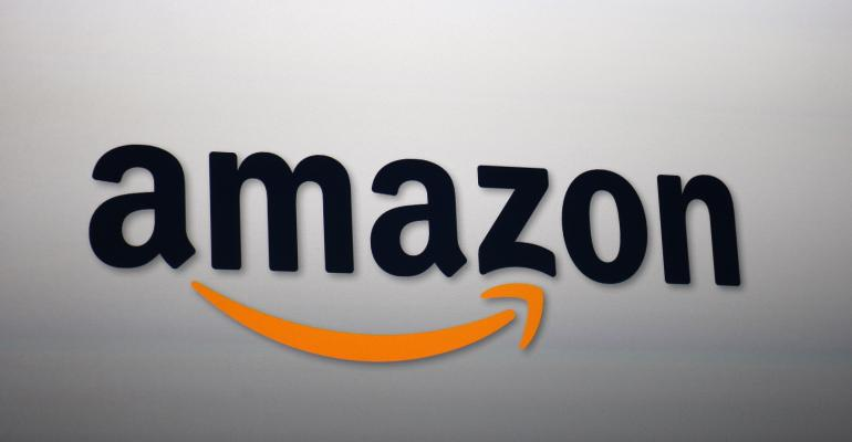 SANTA MONICA, CA - SEPTEMBER 6:  The Amazon logo is projected onto a screen at a press conference on September 6, 2012 in Santa Monica, California.  Amazon unveiled the Kindle Paperwhite and the Kindle Fire HD in 7 and 8.9-inch sizes. (Photo by David McNew/Getty Images)