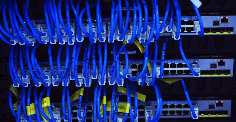 Blue cables connect computer server units at the CeBIT 2017 tech fair in Hannover, Germany, on Tuesday, March 21, 2017. Leading edge technologies in the digital world are showcased in this annual event which runs March 20 - 24. Photographer: Krisztian Bocsi/Bloomberg