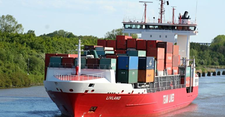 An ark-like container ship moves containers