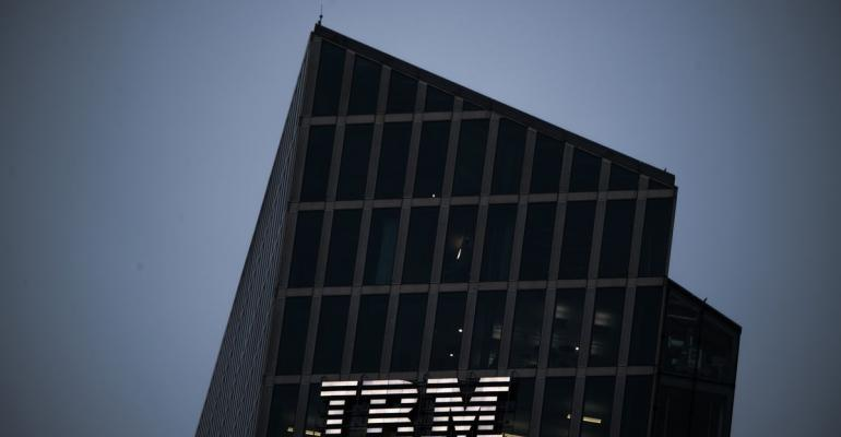 A logo sits illuminated on the International Business Machines Corp. (IBM) Watson cognitive computing platform Internet of Things (IoT) center, at the IoT center in Munich, Germany, on Thursday, Aug. 10, 2017.  Photographer: Andreas Arnold/Bloomberg