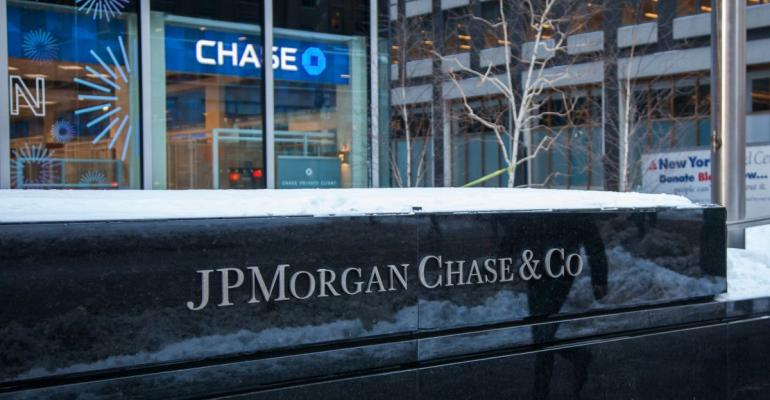 Snow sits on top of signage displayed outside a JPMorgan Chase & Co. bank branch in New York, U.S., on Tuesday, Jan. 9, 2018. JPMorgan Chase & Co. is scheduled to release earnings figures on January 12. Photographer: Daniel Tepper/Bloomberg