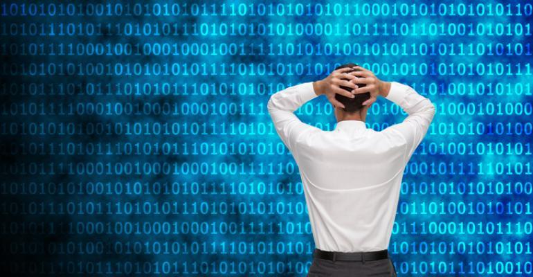 Man in front of code