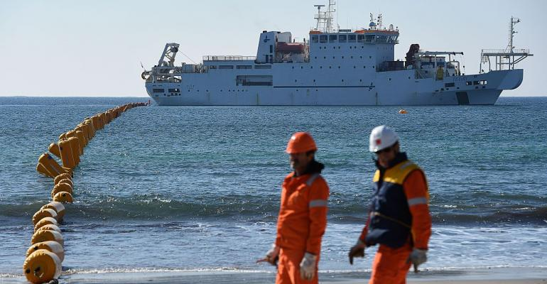 Orange Marine employees deploying the SEA-ME-WE 5 submarine cable, linking Singapore to France, in March 2016 in front of the cable ship Teliri in La Seyne-sur-Mer, southern France.