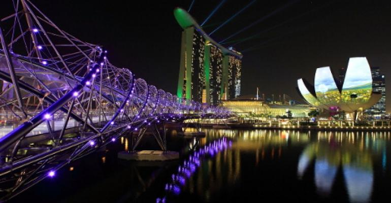 A view of the Helix Bridge, Marina Bay Sands, ArtScience Museum and the city skyline in Singapore.