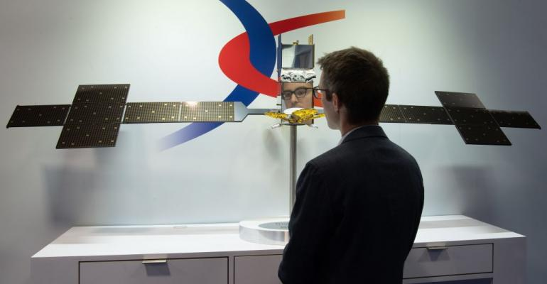 A visitor looks at a model of a ThalesAlenia SES-17 satellite at Satellite2019 in Washington, DC, in May 2019.