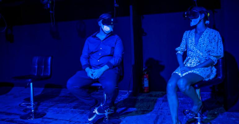 Two people use the VR experience at Claude Monet – The Immersive Experience Exhibitionat Teatro Degli Arcimboldi in July 2020 in Milan. VR is often touted as one of the main use cases for edge computing.