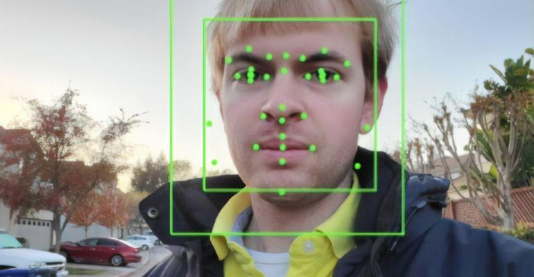 Output of an Artificial Intelligence system from Google Vision, performing Facial Recognition on a photograph.