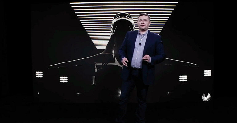 Boom Supersonic CEO Blake Scholl standing in front of jet