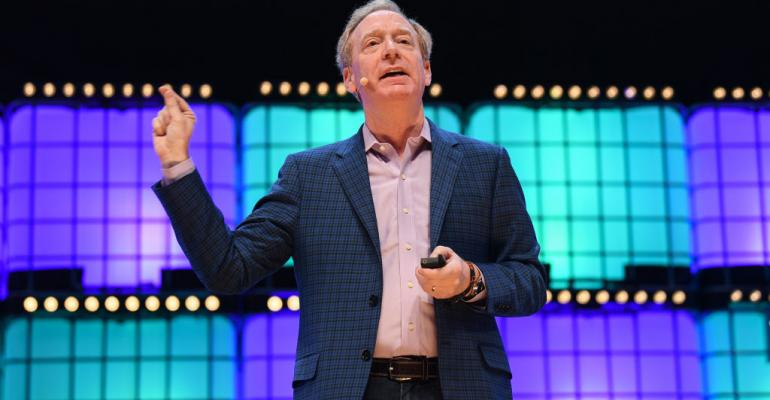 Microsoft president Brad Smith speaking at Web Summit in Lisbon in November 2018