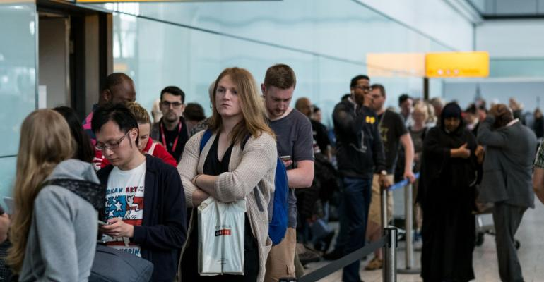 People queue to speak to British Airways representatives at Heathrow Airport Terminal 5 on May 28, 2017 in London, England. Thousands of passengers had their travel disrupted after a BA IT failure caused the airline to cancel most of its services.