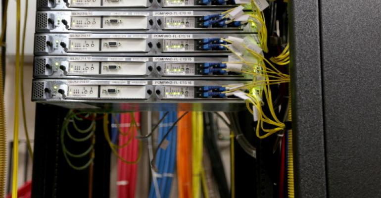Cables and routers at a Comcast distribution center