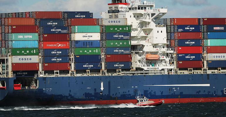 A fully loaded cargo ship heads into New York Harbor in August 2016.