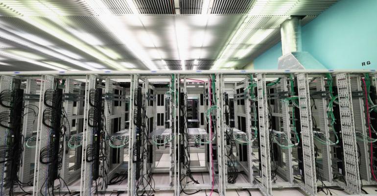 Empty racks at a CERN data center, 2017