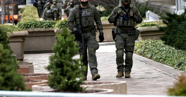 Federal law enforcement officers patrol the grounds of the Department of Justice on January 17, 2021 in Washington, DC, as preparations are made for Joe Biden's presidential inauguration.