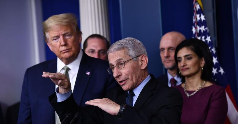 Dr. Anthony Fauci speaks as US President Donald Trump listens during the daily press briefing on the Coronavirus pandemic situation at the White House on March 17, 2020 in Washington, DC.