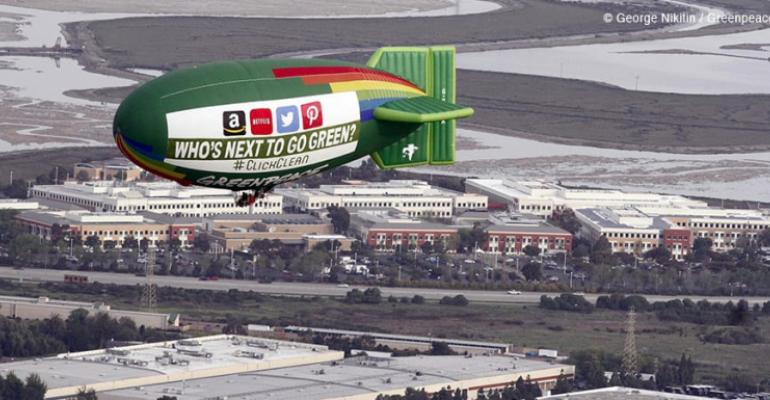 """The Greenpeace Airship A.E. Bates flies over Silicon Valley in 2014 with a banner asking """"Who's The Next To Go Green?"""""""