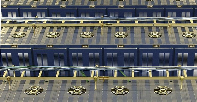 Overhead view of the cabinets and cable trays inside Hurricane Electric's Fremont 1 data center.