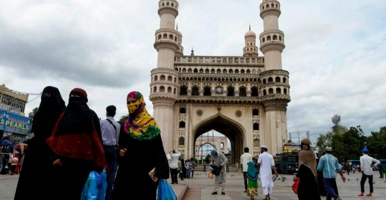 Muslim women walk around historic monument Charminar area in the old city of Hyderabad on August 5, 2020.