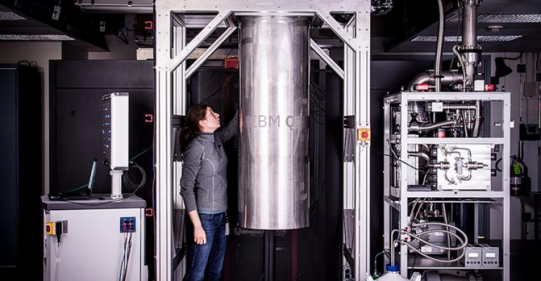 IBM Research Staff Member Katie Pooley is examining a cryostat with the new prototype of a commercial quantum processor inside.