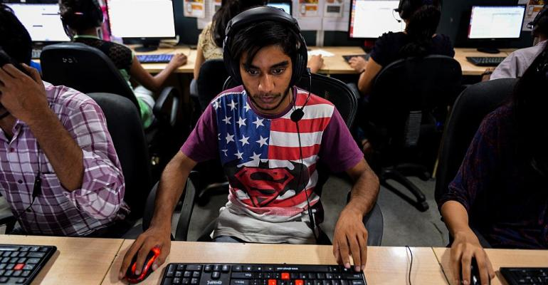 An Indian man works at a call center of TravelKhana in Noida.