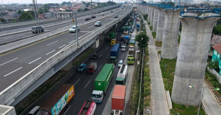 Motorists commuting to Jakarta on a road in Bekasi in May 2021