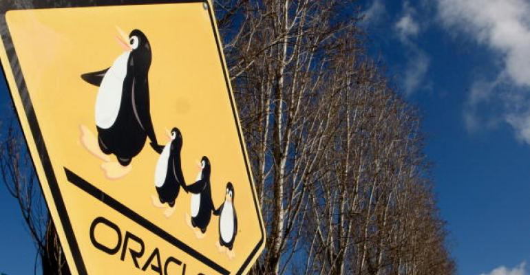 A sign with Linux penguins is seen in front of the Oracle headquarters in Redwood Shores, California, seen in 2007.