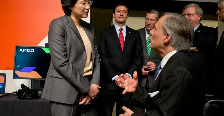 Advanced Micro Devices (AMD) President and CEO Lisa T. Su greets Texas Governor Greg Abbott.