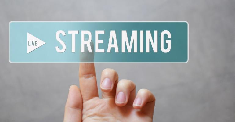 finger pushing live streaming button