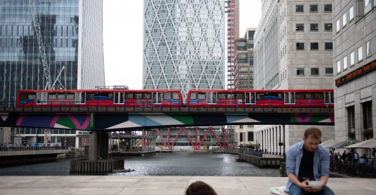 Canary Wharf, \a Docklands Light Railway (DLR) train passing by in August 2019