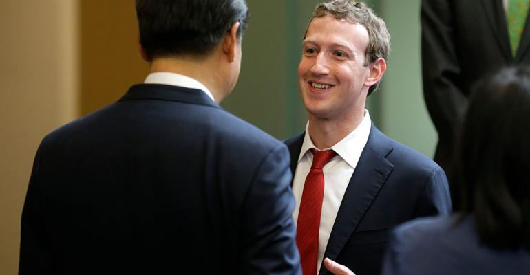 Chinese President Xi Jinping, left, talks with Facebook CEO Mark Zuckerberg, right, during a gathering of CEOs and other executives at Microsoft's main campus September 23, 2015 in Redmond, Washington.