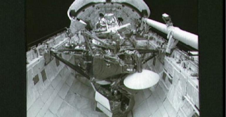 The Upper Atmosphere Research Satellite (UARS) sits in the cargo bay of the Space Shuttle Discovery in September, 1991 in space.
