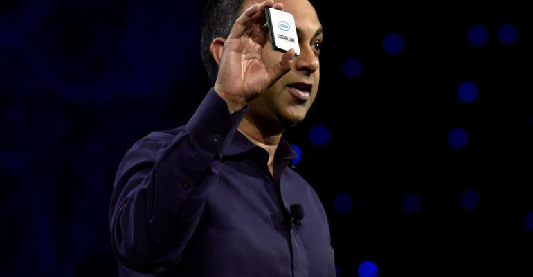 Intel Executive VP and General Manager Data Center Group Navin Shenoy displays a Cascade Lake chip during an Intel press event for CES 2019 in Las Vegas.