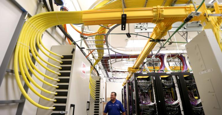 Network cables and routers in a telecom distribution center