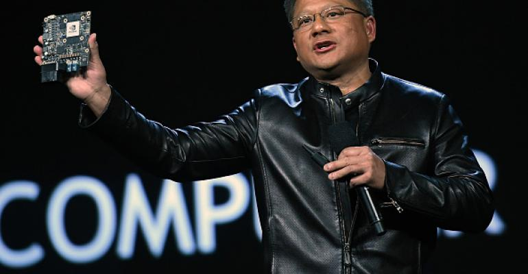 Nvidia Founder, President and CEO Jen-Hsun Huang displays Nvidia's Xavier AI car supercomputer at CES 2017 at The Venetian Las Vegas in January 2017.