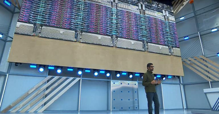Alphabet CEO Sundar Pichai shows a photo of a liquid-cooled TPU 3.0 pod inside a Google data center at I/O 2018