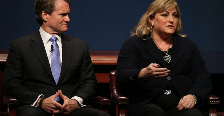 Renee James (R), then Intel president, speaks during the White House Summit on Cybersecurity and Consumer Protection in 2015 in Stanford, California, as Bank of America chairman and CEO Brian Moynihan looks on.