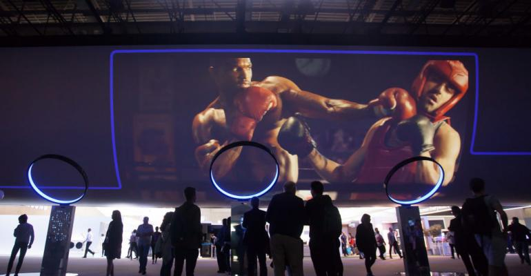 Visitors try out GEAR virtual reality goggles at the Samsung stand at the 2017 IFA consumer electronics and home appliances trade fair in September 2017 in Berlin