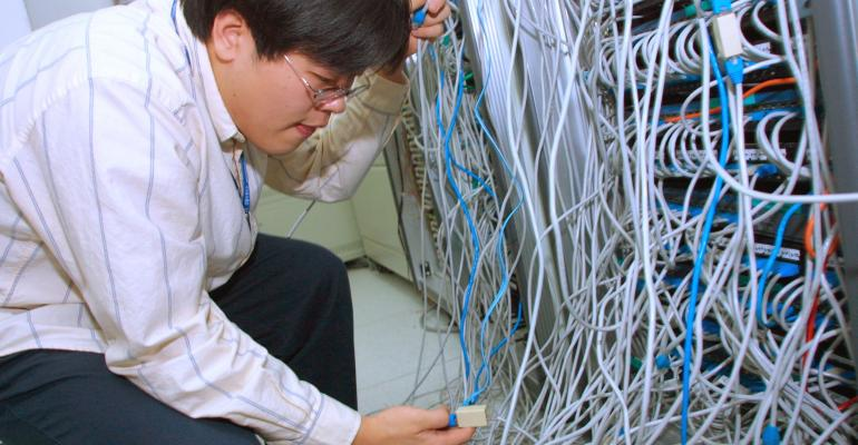 """South Korean engineer checks systems after a worm called """"SQL Slammer"""" attacked internet servers in the country in 2003"""