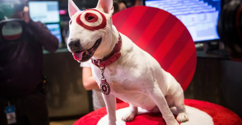 Bullseye, an English Bull Terrier and a mascot for Target, visits the floor of the New York Stock Exchange in 2014