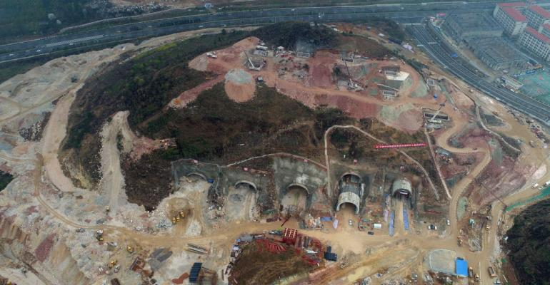 Aerial view of Tencent's biggest data center under construction in the mountainous area of the hinterland in March 2018 in Anshun, Guizhou Province of China.