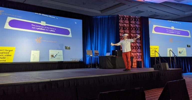 Toshi Anders Hoo, director of the Emerging Media Lab at the Institute for the Future, making a live VR demo in a keynote at Data Center World 2021 in Orlando, Florida.