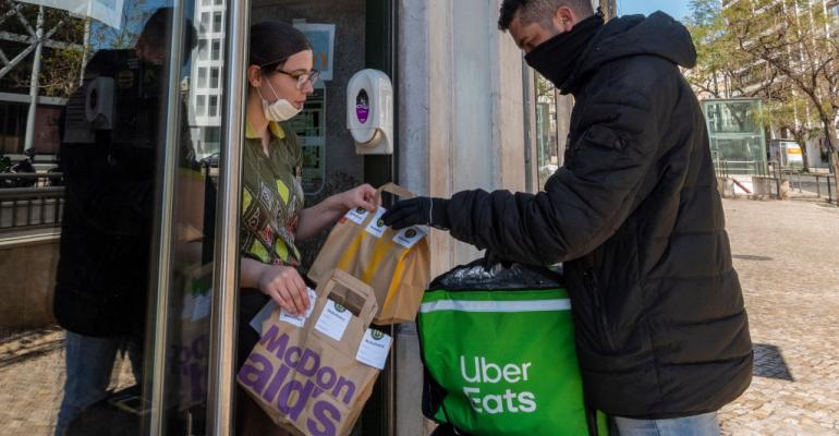 An Uber Eats driver picks up a food orders to be delivered at a McDonald's fast food restaurant on March 22, 2020 in Lisbon, Portugal.